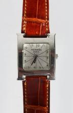 A HERMES STAINLESS STEEL WRIST WATCH,  with leather strap