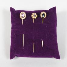 THREE GOLD TIE PINS, set with seed pearls