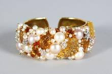 A SUPERB 18ct GOLD BRACELET BY J. GIODORO, set with pearls of varying sizes, diamond leaves in coloured glass, signed J. GIODORO. Total weight 106 grams