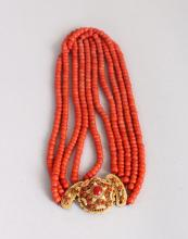 AN IMPRESSIVE FOUR ROW CORAL NECKLACE, with 18ct gold clasp.