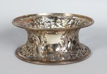 A SILVER DISH RING, London 1902, Maker: D.W. & J.W., with pierced decoration depicting Chinese figures, ho-ho birds and flowers. <br>8ins diameter.
