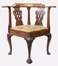 A GEORGE III MAHOGANY CORNER ARMCHAIR, with pierced back splats, leather upholstered drop-in seat, on carved cabriole legs, labelled to the underside