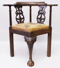A GEORGE III STYLE MAHOGANY ARMCHAIR, with carved and pierced back splats, leather upholstered drop-in seat, on carved cabriole legs.