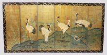 A 20TH CENTURY CHINESE PAINTED SIX PANEL SCREEN, decorated with a scene with cranes on a pond. <br>8ft 0ins wide x 4ft 0ins high.