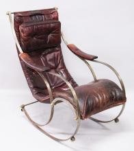R. W. WINFIELD, A WROUGHT IRON ROCKING CHAIR, CIRCA. 1850, with buttoned burgundy leather upholstery.