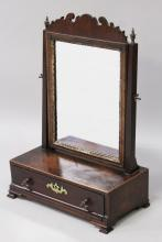 A GOOD GEORGE III MAHOGANY DRESSING TABLE MIRROR, the rectangular mirror plate with fretwork cresting above a base with a single drawer on ogee bracket feet. <br>1ft 0ins wide x 1ft 6ins high.