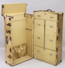 A VELLUM COVERED WARDROBE TRUNK, EARLY 20TH CENTURY, the interior fitted with rails and drawers. <br>3ft 4ins high x 1ft 10ins wide x 1ft 6ins deep.