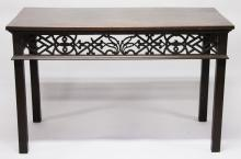 A GEORGE III MAHOGANY RECTANGULAR TOP TABLE with pierced frieze, supported on square legs. <br>4ft wide.
