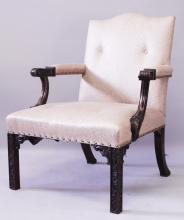 A GOOD 19TH CENTURY CHINESE CHIPPENDALE STYLE MAHOGANY GAINSBOROUGH CHAIR with blind fret carving padded back, arms and seat.