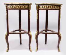 A GOOD PAIR OF LINKE MODEL MARQUETRY TABLES with ormolu mounts and shaped under-tier with ormolu mounts. <br>2ft 9ins high.