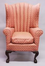 A GEORGIAN MAHOGANY HIGH BACK TUB ARMCHAIR, supported on short cabriole legs ending in claw and ball feet.