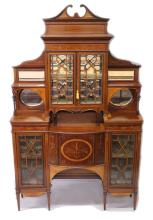 A SUPERB MAHOGANY AND MARQUETRY INLAID CABINET by EDWARDS & ROBERTS, with swan neck pediment, dentil moulded cornice over a pair of astragal glazed doors enclosing a mirror backed interior, flanked by open shelves with mirrors behind, above a bowfronted door flanked by a pair of astragal glazed doors, all profusely inlaid with classical motifs, supported on slender tapering square legs, stamped EDWARDS & ROBERTS. <br>7ft 4ins high x 4ft 7ins wide x 1ft 3ins deep.