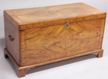 A GOOD 18TH CENTURY WALNUT CHEST with crossbanded rising top, brass carrying handles to the sides and supported on bracket feet. <br>3ft 11ins long.