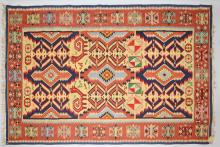 AN INDIAN KELIM RUG of typical design, with animals and motifs. <br>8ft 5ins x 4ft 6ins.