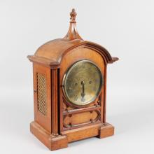 A 19TH CENTURY GOTHIC STYLE OAK BRACKET CLOCK by J. TRUSCOTT, ABERYSTWYTH, with circular brass dial, eight-day movement and strike action. <br>18ins high, including finial.