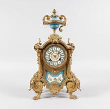 A 19TH CENTURY FRENCH ORMOLU AND SEVRES PANEL CLOCK with eight-day movement, striking on a single bell with urn finial and Sevres porcelain panels. <br>14ins high.