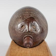 A 19TH CENTURY PARTIALLY CARVED COCONUT FLASK AND STOPPER. <br>6.5ins.