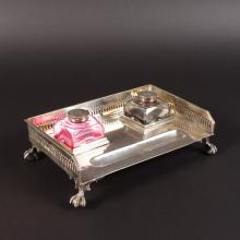 A PLATED INKSTAND with two bottles.