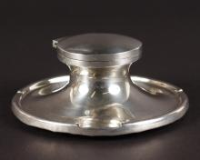 A CAPSTAN CIRCULAR INKWELL. <br>4.5ins diameter.  London 1939.