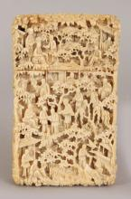A GOOD 19TH CENTURY CHINESE CANTON IVORY CARD CASE, well carved in deep relief with an overall design of diminutive figures in terrace settings, 4.2in x 2.5in.