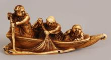 A JAPANESE MEIJI PERIOD STAINED IVORY NETSUKE BY GYOKKO, carved in the form of two men and a boy in a river fishing boat, the base with an engraved signature, 3.1in long & 1.5in high.