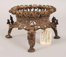 A KHMER PIERCED BRONZE TRIPOD STAND, possibly 12th/13th Century, each foot cast with a stylised peacock, 6in wide at widest point & 3.8in high.