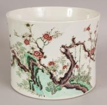 A GOOD LARGE 18TH CENTURY CHINESE FAMILLE VERTE PORCELAIN BRUSHPOT, Bitong, the sides of the slightly waisted cylindrical body painted with rockwork, bamboo and extended plum blossom beside a bird in flight and insects, the base partially unglazed, 7.75in diameter at rim & 6.1in high.