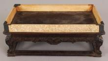 A GOOD 19TH CENTURY CHINESE RECTANGULAR HARDWOOD & IVORY STAND, supported on four scroll feet above connecting stretchers, and surmounted by a galleried ivory rim carved with confronting dragons, 8.25in x 4.7in x 3.1in.