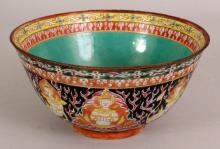 A GOOD 18TH/19TH CENTURY CHINESE THAI MARKET PORCELAIN BOWL, circa 1800, the sides painted with alternating Thepanom and Norasingh figures reserved on a flaming kranok ground, 6.9in diameter & 3.5in high.