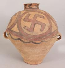 A LARGE CHINESE NEOLITHIC BANSHAN POTTERY JAR, possibly Majiayao Culture, painted with wan swastika patterns, the sides with two lug handles, 12.9in high.