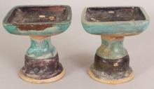 AN UNUSUAL PAIR OF CHINESE MING DYNASTY FAHUA POTTERY TAZZAS, each applied with aubergine and turquoise glazes, 4.25in square & 4.4in high.