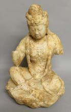 A GOOD QUALITY CHINESE CARVED MARBLE FIGURE OF A SEATED BODHISATTVA, possibly Tang/Liao Dynasty, the figure seated in sattvaparyanka upon a lotus plinth, the slightly downcast visage with finely carved features, dressed in flowing dhoti with necklace and tasselled jewellery, 16.25in high.