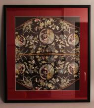 AN UNUSUAL 19TH CENTURY FRAMED CHINESE CHAIR BACK EMBROIDERY, decorated on a black ground with phoenix roundels and floral sprays, the frame 30.8in x 27.1in.