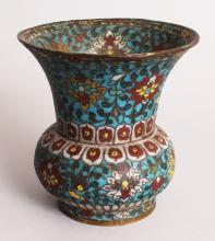 A CHINESE CLOISONNE VASE, possibly 17th Century, the squat ovoid body and flaring neck decorated with formal scrolling lotus reserved on a turquoise ground, 4.75in diameter at neck rim & 4.7in high.