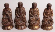 FOUR 19TH CENTURY CHINESE LACQUERED AND GILDED WOOD FIGURES OF BUDDHA, in meditative and prayerful attitudes, the tallest 6.9in high. (4)