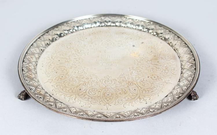 A VICTORIAN CHASED CIRCULAR SALVER, engraved and dated 1874. 12ins diameter. London 1870. Makers: Martin Hall & Co. Weight 28ozs.