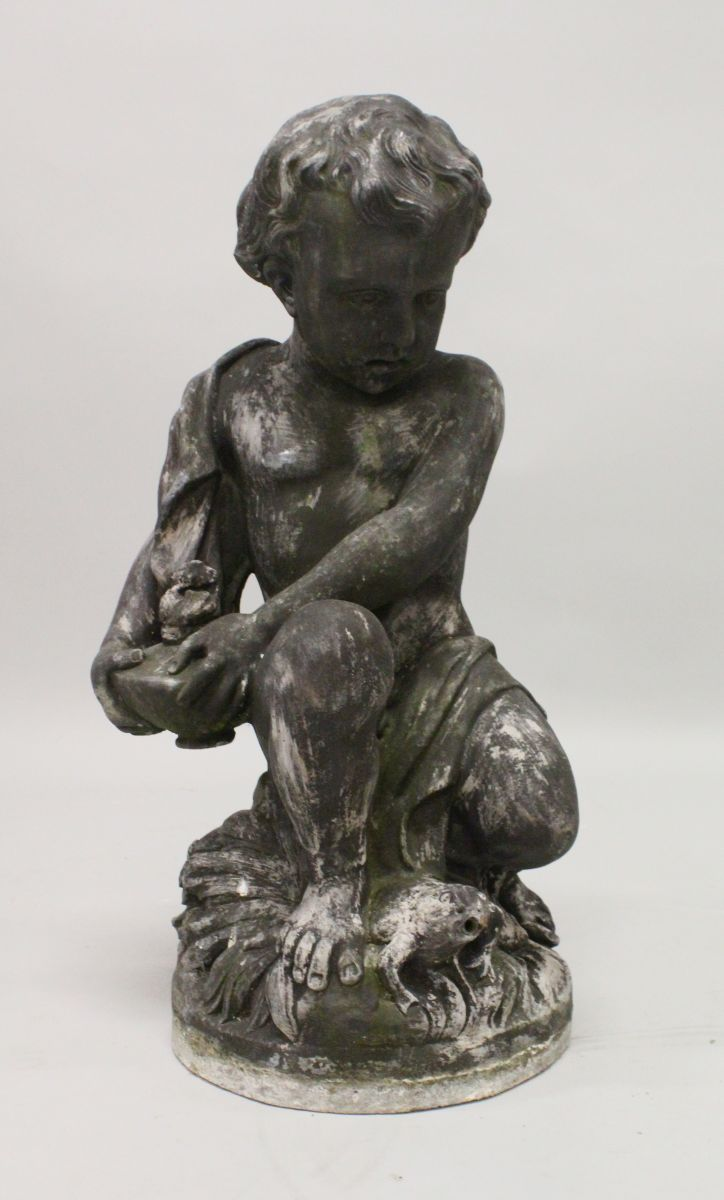 A LEAD GARDEN FOUNTAIN, PROBABLY 19TH CENTURY, modelled as a seated cherub, holding a lamp with a frog at its feet. 2ft 1ins high.