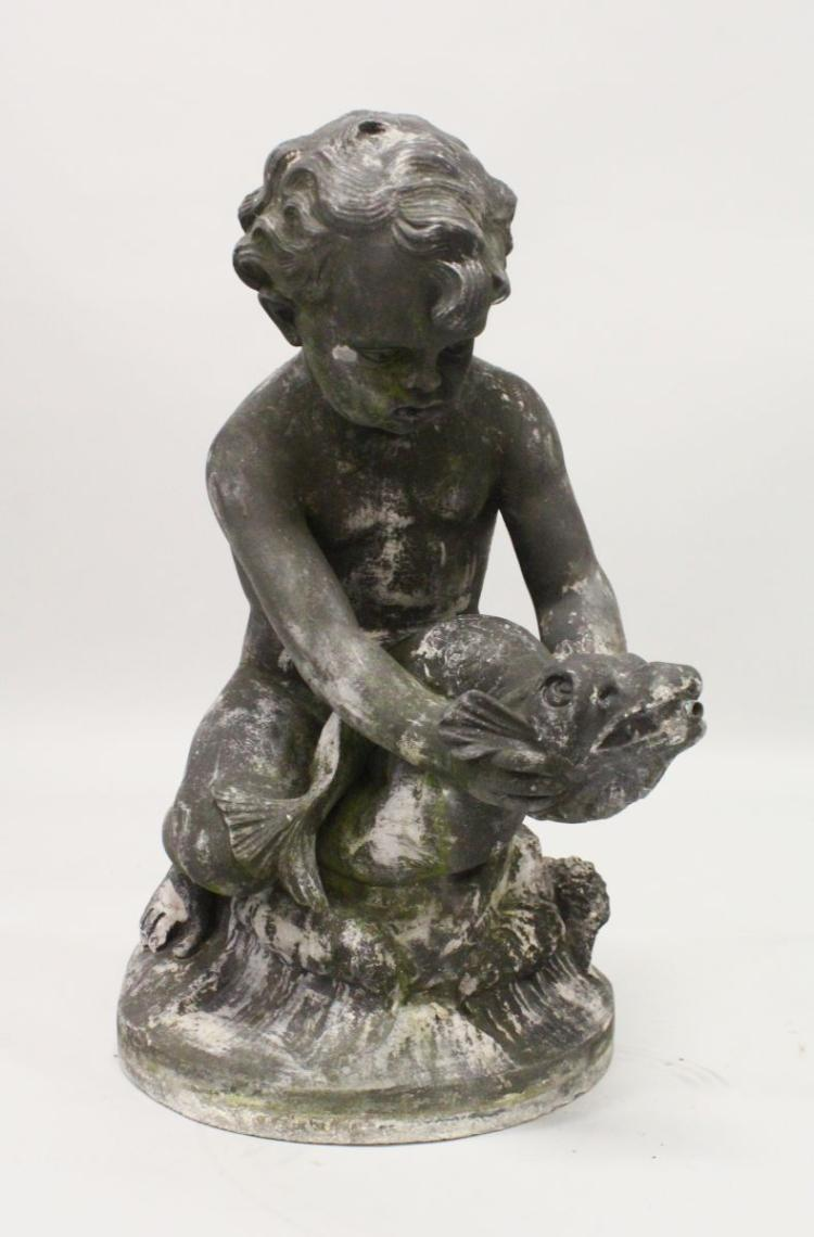 A LEAD GARDEN FOUNTAIN, PROBABLY 19TH CENTURY, modelled as a seated cherub riding on a classical dolphin, on a circular base. 2ft 0ins high.