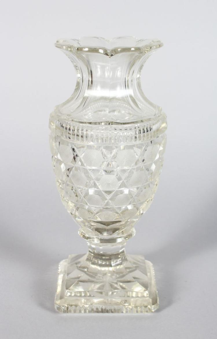 A DEEP CUT FLOWER VASE, on a square star cut base 8.5in high