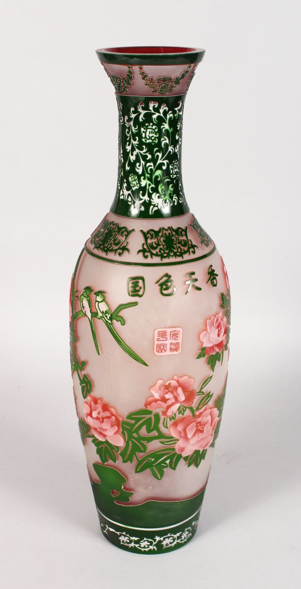 A LARGE PEKING GLASS TYPE VASE of Chinese design with birds and calligraphy. 17ins high.