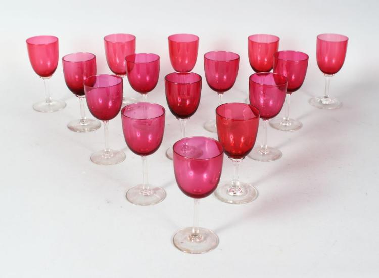 A NEAR SET OF FOURTEEN RUBY GLASS WINE GLASSES.