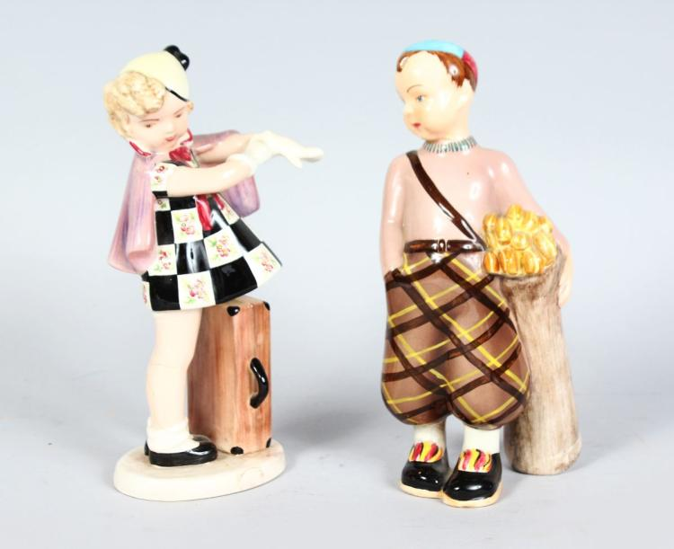 A PAIR OF GOLDSCHEIDER FIGURES, BOY WITH GOLF CLUBS AND GIRL PUTTING ON GLOVES. 7.5ins high.
