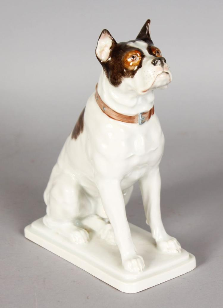 A SUPERB MEISSEN FIGURE OF A SEATED DOG, on a rectangular base. Cross swords mark in blue. 7ins high.