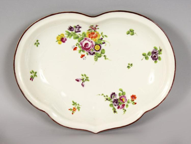 A GOOD WORCESTER CRESCENT SHAPED DISH, painted with flowers. 11ins wide.