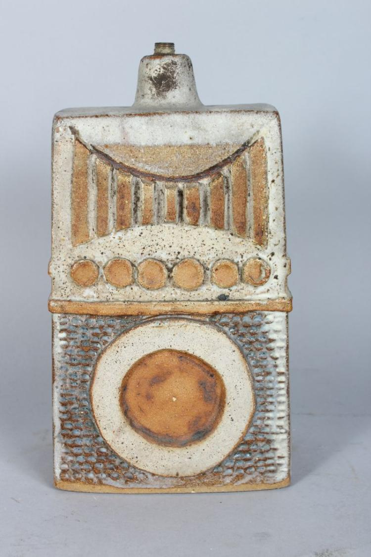 A STUDIO POTTERY LAMP BASE, CIRCA. 1960'S, of tapering slab form with applied decoration. 11ins high.