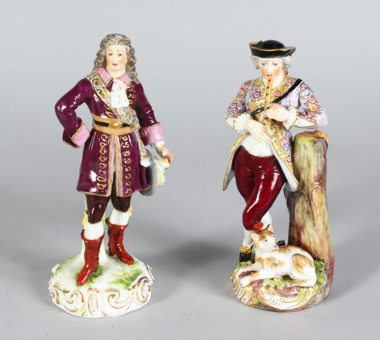 TWO MEISSEN PORCELAIN FIGURES OF A DANDY with sword and plumed hat, and another with a young man playing a pipe, a dog by his side Cross Swords Mark in Blue. Both 7ins high.