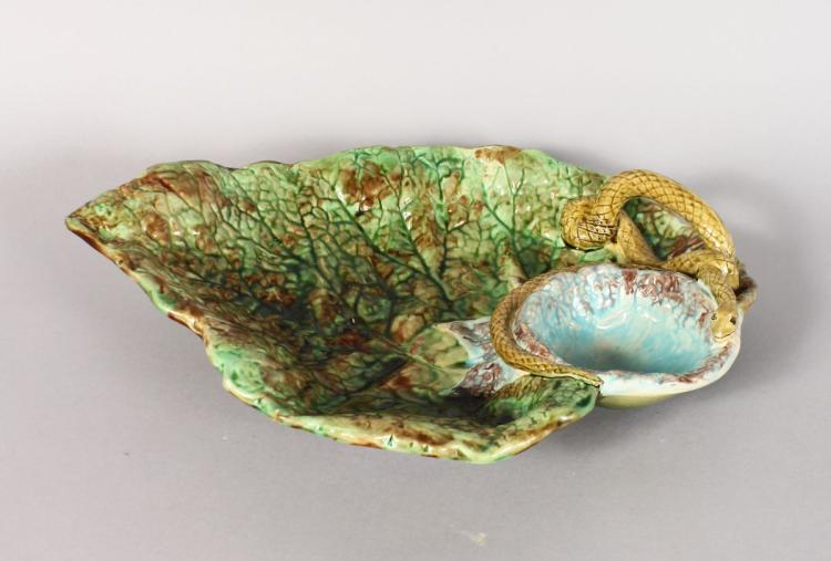 A MAJOLICA DISH with snake handle. 13ins long.