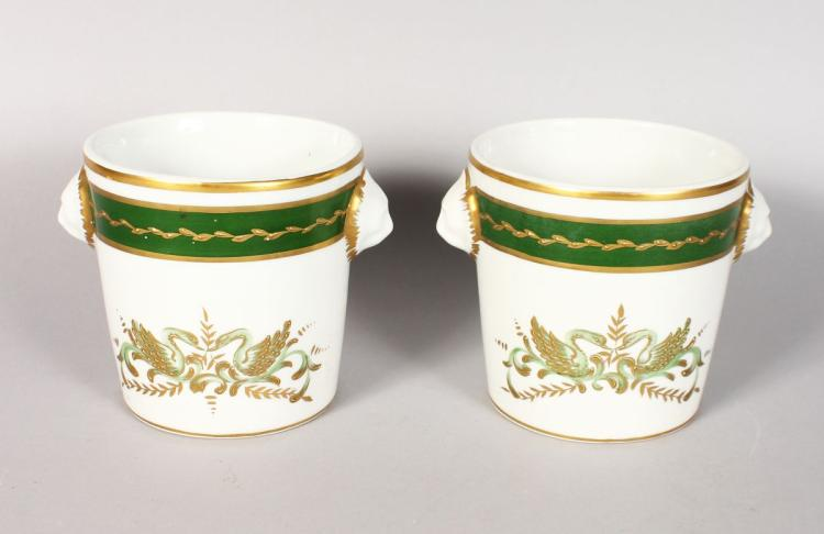 A PAIR OF LIMOGES JARDINIERES with swans and lion handles. 4.5ins high.