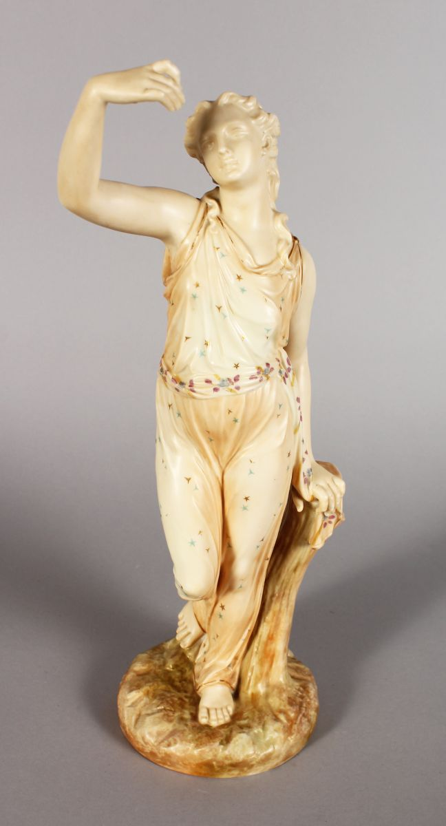 A ROYAL WORCESTER FIGURE OF A CLASSICAL GIRL, standing beside a tree stump. 14ins high.