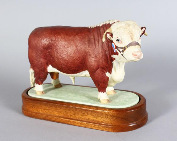 A ROYAL WORCESTER HEREFORD BULL, modelled by DORIS LINDER 1959, on a wooden base. 6ins long.
